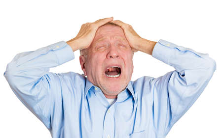 Closeup portrait elderly business man, sad grandfather suffering from severe migraine, receiving bad news, crying, screaming isolated white background. Geriatrics, depression, health issues. Emotions Stock Photo