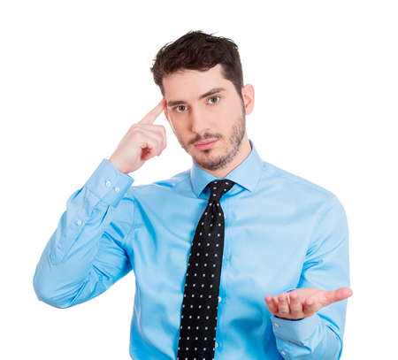 bonkers: Closeup portrait of confused, difficult, calm young man, gesturing with finger against his temple, are you crazy? Isolated on white background. Negative human emotions, facial expressions, feelings