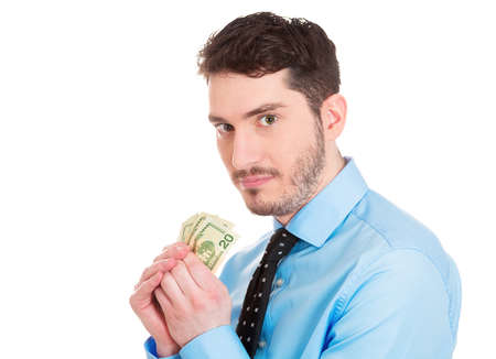 pennypinching: Closeup portrait of greedy banker executive CEO boss, corporate employee funny looking man, shaking holding dollar banknotes scared to lose money, suspicious isolated on white background. Expressions