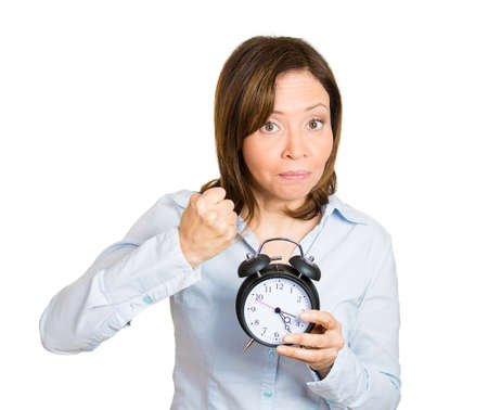 requesting: Closeup portrait of angry, demanding boss, woman, funny looking girl, holding alarm clock, requesting employees to be on time pushing for project deadline isolated white background. Negative emotion