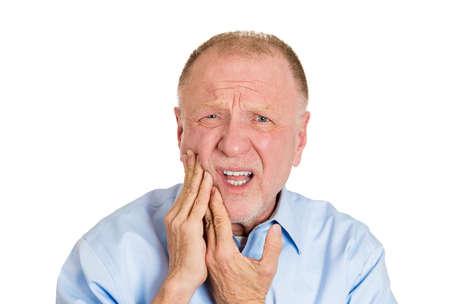 Closeup portrait elderly business man with tooth ache crown problem cavity crying from pain touching outside mouth with hand isolated white background. Negative human emotion facial expression feeling photo