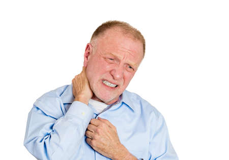 stenosis: Closeup portrait stressed senior mature business man, elderly guy with bad tight sprained muscle neck pain, spasm isolated white background. Negative human emotion, facial expressions, health issues