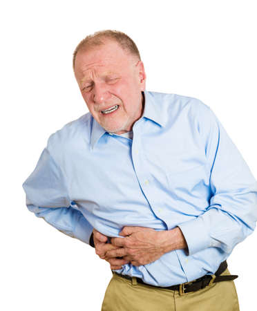 miserable: Closeup portrait senior executive old man, elderly corporate employee grandfather looking miserable, doubling over in stomach, spleen pain, isolated white background. Nephrolithiasis. face expression Stock Photo