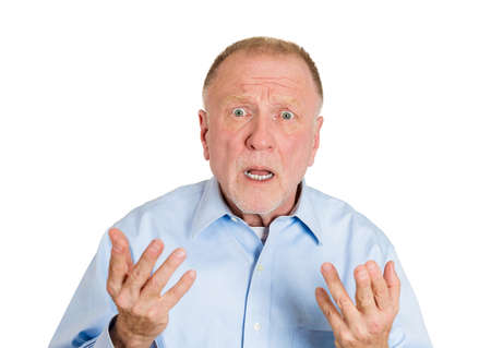 Closeup portrait of pissed off senior mature man, hands in air, asking come on, how could you do this to me, isolated white background. Negative human emotion facial expression feelings, body language Stock Photo