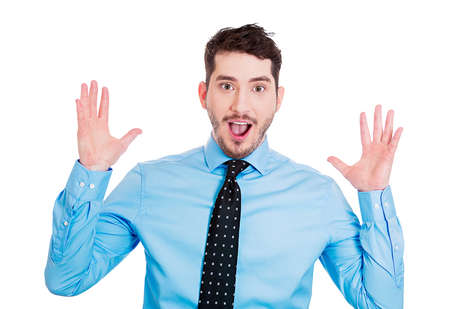 surprised man: Closeup portrait of handsome, startled, surprised, shocked, stunned young man, in full disbelief, hands in air, isolated on white background. Human face expressions, emotions, reaction, perception Stock Photo