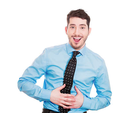 doubled: Closeup portrait of handsome young, mirthful business man, employee, doubled over laughing, isolated on white background. Positive human emotions facial expressions, feelings, attitude perception