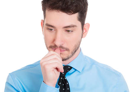 Closeup portrait of thinking man with finger in mouth, sucking thumb, biting fingernail in anxiety, stress, deep in thought, isolated on white background. Negative emotion, facial expression, feelings photo