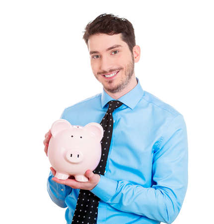 college fund savings: Closeup portrait of rich, super excited young successful, happy man, student, worker, holding his friend, piggy bank, isolated on white background. Financial decisions, money savings, college fund