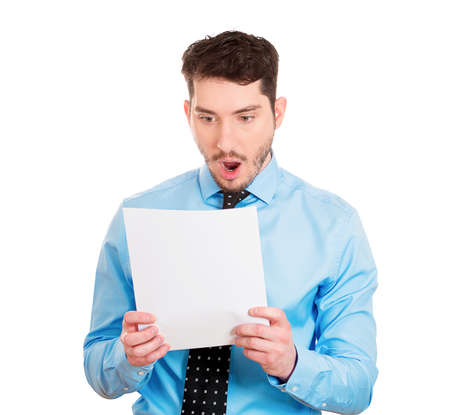 bank records: Closeup portrait of sad, shocked funny looking young man disgusted at his monthly bills, isolated on white background. Negative human emotion facial expression feelings. Financial crisis, bad news
