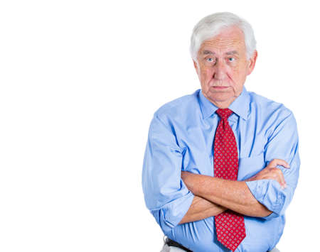 dissenting: A close-up portrait of a senior executive, elderly man, grandfather with a very skeptical, annoyed attitude, isolated on a white background with copy space. Human personalities, conflict resolution.