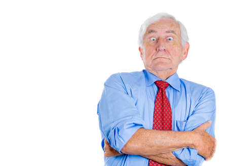 Closeup portrait of an old guy, senior executive, grandfather, with disgust on his face, something stinks,he is very displeased with the situation, isolated on white background. Interpersonal conflict photo