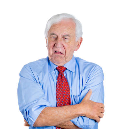 bad breath: Closeup portrait of an old guy, senior executive, grandfather, with disgust on his face, something stinks,he is very displeased with the situation, isolated on white background. Interpersonal conflict Stock Photo