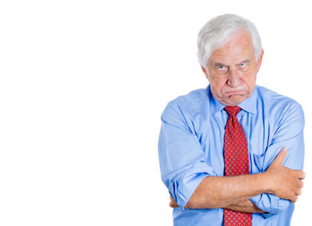 enrage: Closeup portrait of an old guy, senior executive, grandfather, with disgust on his face, something stinks,he is very displeased with the situation, isolated on white background. Interpersonal conflict Stock Photo