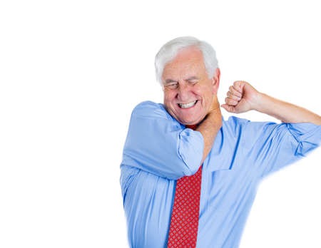 geriatrics: Closeup portrait of elderly, senior corporate employee, mature man in great excruciating neck pain, isolated on white background. Geriatrics health issues and problems. Osteoarthritis management Stock Photo