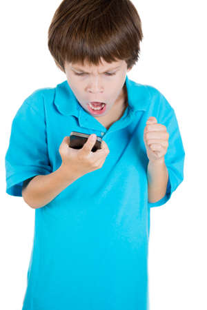 dismayed: Closeup portrait of adorable boy holding cell phone in hands and shocked by what he sees isolated on white background with copy space