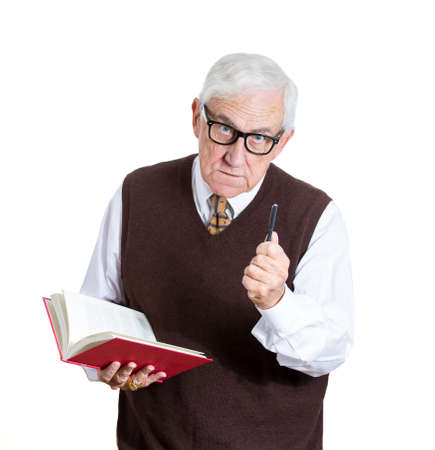 Closeup portrait of a senior elderly teacher holding a book and a pen, looking very serious, unhappy and grumpy, isolated on white background. Human emotions and facial expressions. Education concept photo