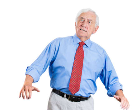 unexpected: Closeup portrait of a senior executive man with hands up, surprised, shocked, scared, in denial ,isolated on white background. Bad unexpected news or unpleasant conversation. Conflict situation. Stock Photo