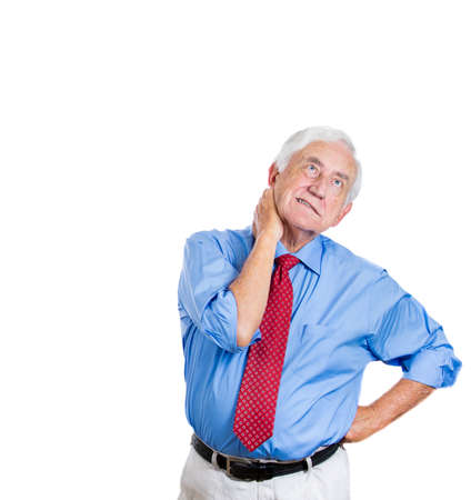 geriatrics: Closeup portrait of elderly, senior corporate employee, mature man in great excruciating neck or back pain, isolated on white background. Geriatrics health issues and problems. Osteoarthritis