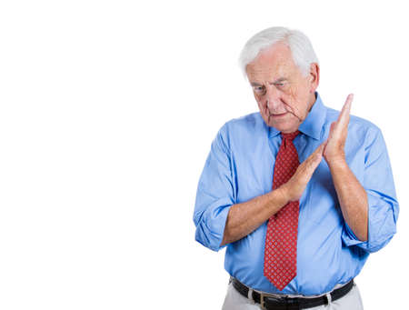 Closeup portrait of an elderly executive, old corporate employee, grandfather, senior man deep in thought, troubled with something, sad and concerned, isolated on a white background with copy space photo