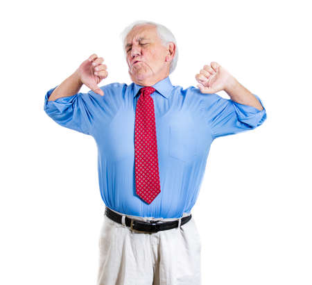 Portrait of exhausted sleepy, tired, bored elderly executive man, old businessman, yawning widely, stretching his back, isolated on a white background. Sleep deprivation, long meeting or working day photo