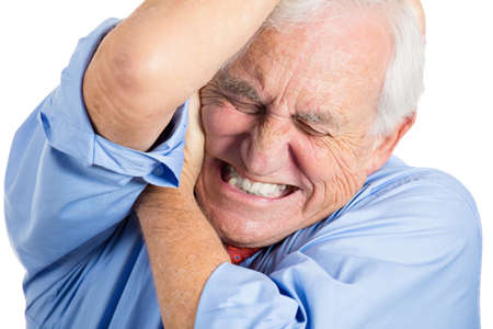 excruciating: Closeup portrait of elderly, senior, mature man in great excruciating pain, isolated on white background