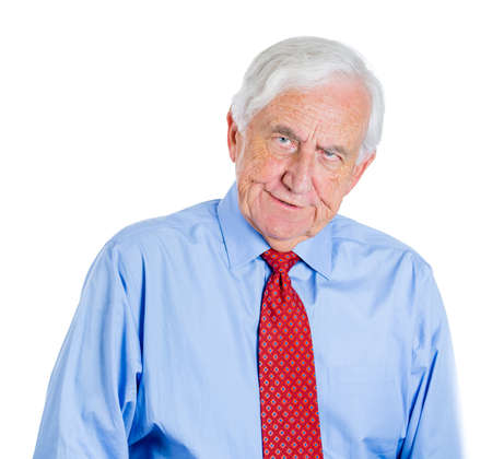 interpersonal: Closeup portrait of an old guy, senior executive, grandfather, with disgust on his face, something stinks,he is very displeased with the situation, isolated on white background. Interpersonal conflict Stock Photo