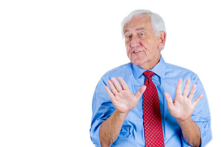 Closeup portrait of a senior executive man with hands up, surprised, shocked, scared, in denial ,isolated on white background. Bad unexpected news or unpleasant conversation. Conflict situation. photo