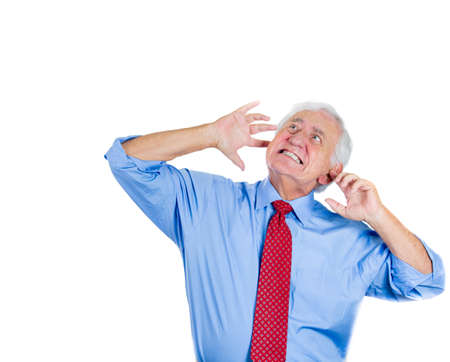 retirement  age: Closeup portrait of an old man, grandfather, corporate executive in blue shirt and red tie covering his ears from loud noise, having a headache isolated on white background.Conflict resolution. Stock Photo