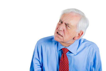Closeup portrait of a senior businessman, elderly man, grandpa listening in on a conversation very intently, looking worried, isolated on white background with copy space. Privacy violation concept photo