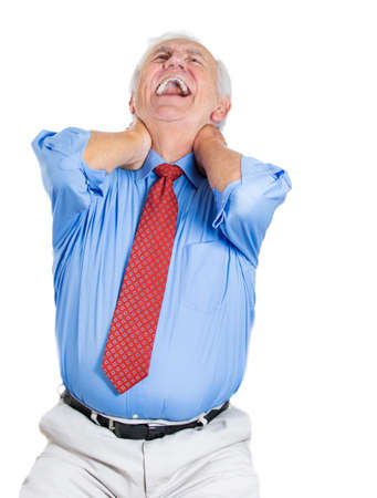excruciating: Closeup portrait of elderly, senior corporate employee, mature man in great excruciating neck pain, isolated on white background. Geriatrics health issues and problems. Osteoarthritis management Stock Photo