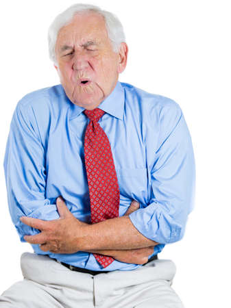 Closeup portrait of senior executive, old man, elderly corporate employee, grandfather looking miserable, very sick, doubling over in stomach, spleen pain, isolated on white background. Heart attack. Stock Photo - 26990506