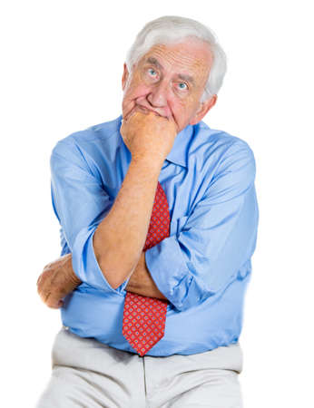 A close-up portrait of an old,sad, thoughtful, lonely man, trying to recall, remember something, isolated on a white background. Geriatrics problems, memory loss, Alzheimers, depression. photo