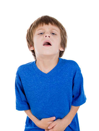 doubled: Closeup portrait of kid doubled over in terrible pain clutching stomach with hands, isolated on white background. Irritable bowel syndrome, health issues Stock Photo