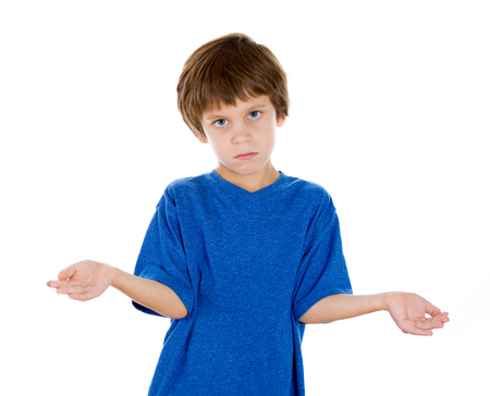 unresponsive: Closeup portrait of adorable kid putting hands out in a gesture that says so what, who cares, isolated on white background. Negative emotion facial expression feelings Stock Photo