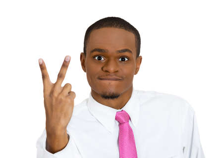 Closeup portrait happy, excited, successful young man giving peace, victory or two sign, isolated white background. Positive emotions, face expressions, feelings, attitude, reaction, perception photo