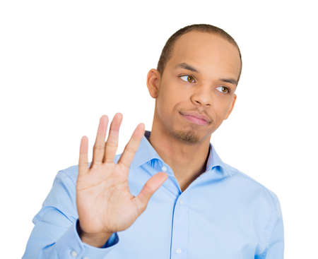Closeup portrait young, handsome, grumpy man with bad attitude giving talk to hand gesture with palm outward, isolated white background. Negative emotions, facial expression feelings, body language