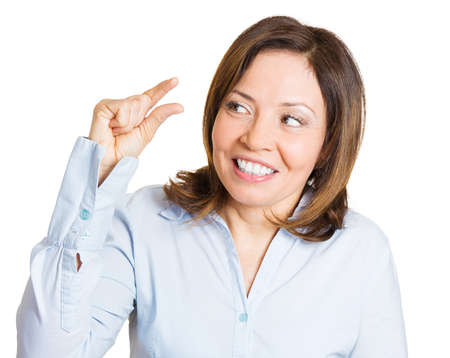 degrading: Closeup portrait, beautiful young woman showing small amount gesture with hands, isolated white background. Human emotion facial expression feelings, body language, signs, symbols.