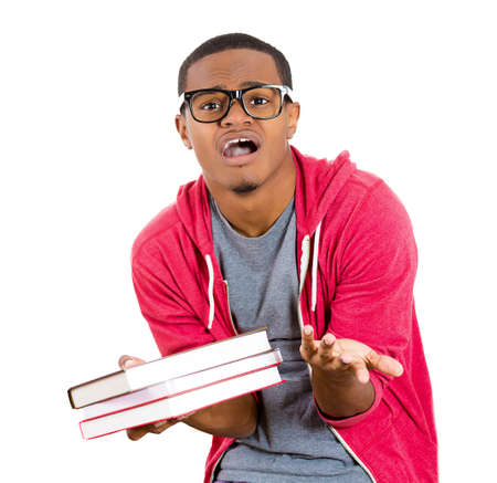 perfectionist: Closeup of a young handsome man, wearing big glasses, holding books, anxious in anticipation of finals, exam test, isolated on white background. Negative facial expressions, feelings, emotions