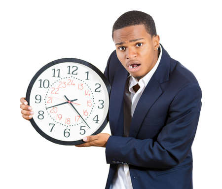 A closeup portrait of a business man, executive, leader holding a clock, very determined, pressured by lack of time, running out of time, late for the meeting, isolated on a white background. Emotions photo