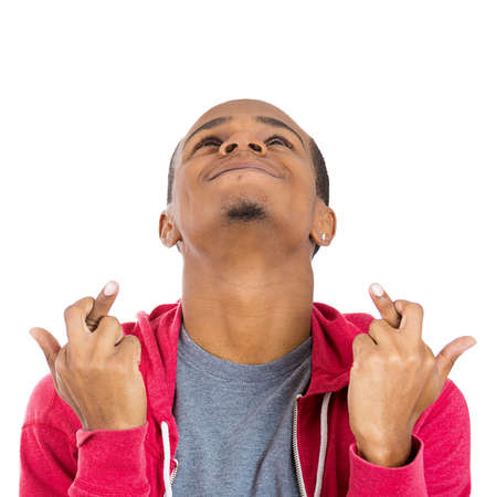 crossing fingers: Closeup portrait of a young handsome man crossing fingers wishing and praying for miracle, hoping for the best, isolated on white background. Positive human emotion facial expression feelings attitude