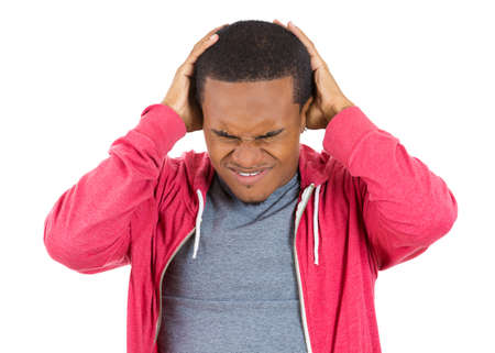 Closeup portrait of really stressed out young man, handsome student with headache, having bad day at work, school, university, isolated on white background. Negative human emotions, facial expressions photo