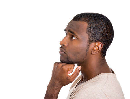 Closeup side view profile portrait, young man, guy, student, employee, worker thinking, daydreaming, wondering, hand on chin, isolated white background. Human face expression, emotions, reaction Stock Photo - 27183586