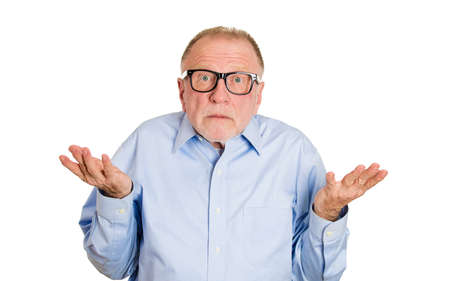 shrug: Closeup portrait, dumb clueless senior mature man, arms out asking why whats the problem who cares so what, I dont know. Isolated white background. Negative human emotion facial expression feelings Stock Photo
