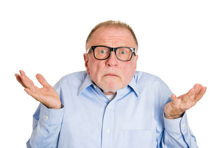 Closeup portrait, dumb clueless senior mature man, arms out asking why whats the problem who cares so what, I dont know. Isolated white background. Negative human emotion facial expression feelings Stock Photo