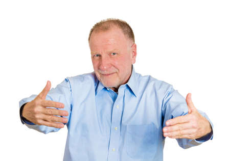 motioning: Closeup portrait, senior mature man motioning with arms to come and give him a bear hug, isolated white background. Positive human emotion facial expression feeling, signs symbols, body language