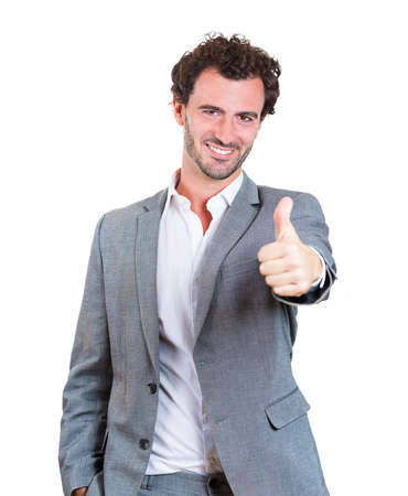 Closeup portrait, happy, handsome, young man in gray blazer showing thumbs up sign gesture, isolated white background. Positive human emotions, facial expressions, feelings, attitude, symbols photo