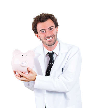 time deficit: Closeup portrait, young mature male man health care professional, dentist, doctor, nurse,  holding piggy bank. Medical insurance, medicare reimbursement, health care reform concept. Hospital budget