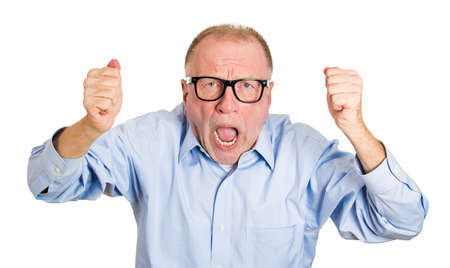 Closeup portrait, upset, senior mature man, worker, mad employee, funny looking business man, fist in air, open mouth yelling, isolated white background. Negative emotion facial expression, reaction photo