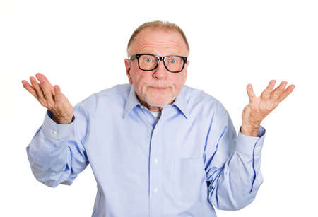 disinterest: Closeup portrait, dumb clueless senior mature man, arms out asking why whats the problem who cares so what, I dont know. Isolated white background. Negative human emotion facial expression feelings Stock Photo