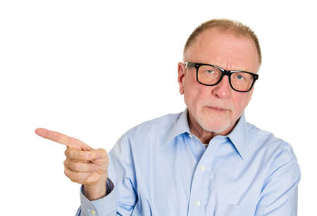 unprofessional: Closeup portrait, serious, senior mature man with big black glasses, pointing to side with index finger, isolated white background. Negative human emotion facial expression feelings, symbols